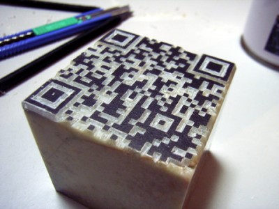 qr-code-cut-on-stone